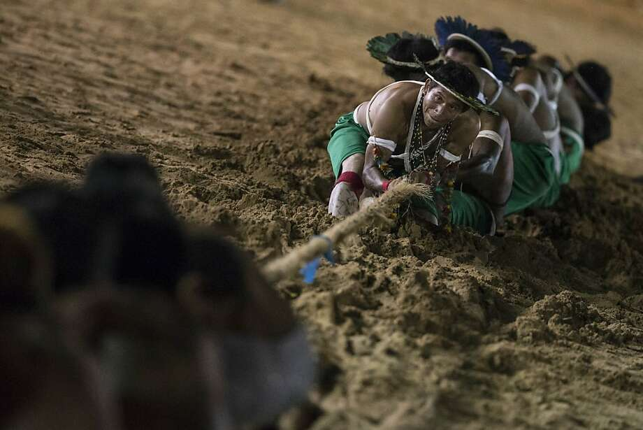 Pull! A Gaviao Indian team strains in a tug of war during the Games of the Indigenous People in Cuiaba, Brazil. Some 1,600 Indians from 48 tribes are taking part in the competition. Photo: Felipe Dana, Associated Press