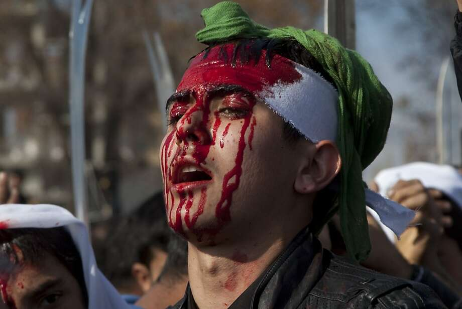 A Turkish Shiite man with a blood running on his face takes part in a religious procession held for the Shiite religious holiday of Ashura on November 13, 2013 in the eastern city of Igdir. Ashura commemorates the death of the grandson of Prophet Muhammad in 680 at the Battle of Karbala, located in Iraq.                     TOPSHOTS/AFP PHOTO / GURCAN OZTURKGURCAN OZTURK/AFP/Getty Images Photo: Gurcan Ozturk, AFP/Getty Images
