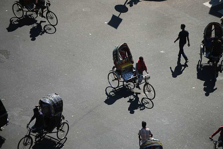 Bangladeshi commuters travel along a street during a nationwide strike called by the opposition Bangladesh Nationalist Party (BNP) in Dhaka on November 13, 2013. Led by the BNP, the 18-Party alliance is trying to enforce a 84-hour general strike across Bangladesh to back their demand for a non-party neutral caretaker to conduct the upcoming parliament polls and to protest the arrest of its senior leaders. TOPSHOTS      AFP PHOTO/ Munir uz ZAMANMUNIR UZ ZAMAN/AFP/Getty Images Photo: Munir Uz Zaman, AFP/Getty Images