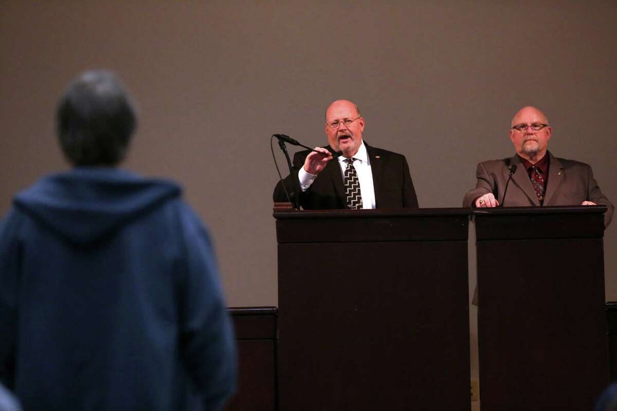 Mark Johnson, IAM aerospace coordinator, left, and District 751President Tom Wroblewski read the results of a vote at the International Association of Machinists union hall in Seattle on Wednesday, November 13, 2013. Both men were booed by union members. IAM members voted and turned down a contract extension that would have cut pension and benefits in exchange for Boeing's commitment to build the 777X in Washington State.