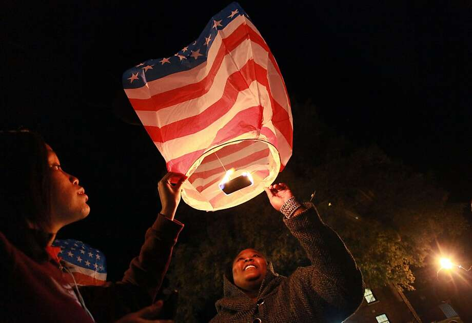 North Carolina Central University senior Jada Bowser, left, and graduate student Nicole Jackson release a lantern into the sky on Wednesday, Nov. 13, 2013, in Durham, N.C.  The university's Veterans Affairs Office held the event to honor veterans and those who currently serve in the military, said Tomeka Davis, veterans affairs coordinator for the university.  (AP Photo/The Herald-Sun, Christine T. Nguyen) Photo: Christine T. Nguyen, Associated Press