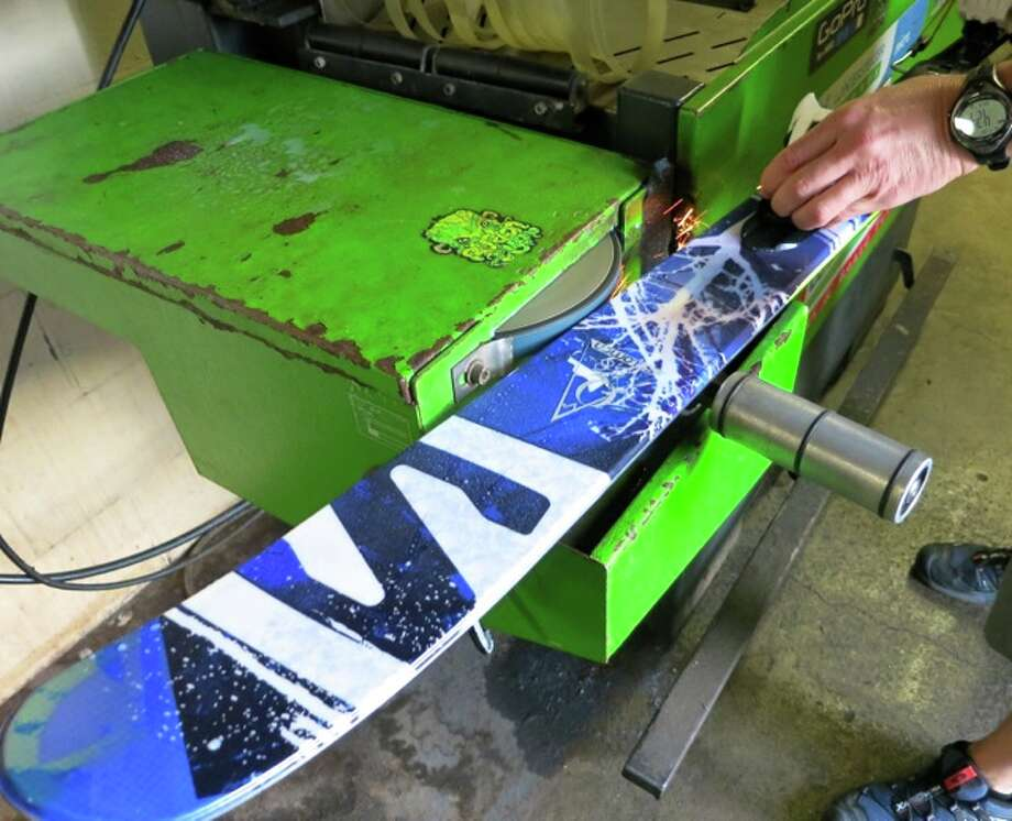 Using a machine to sharpen skis. Photo: Jules Older, Special To The Chronicle
