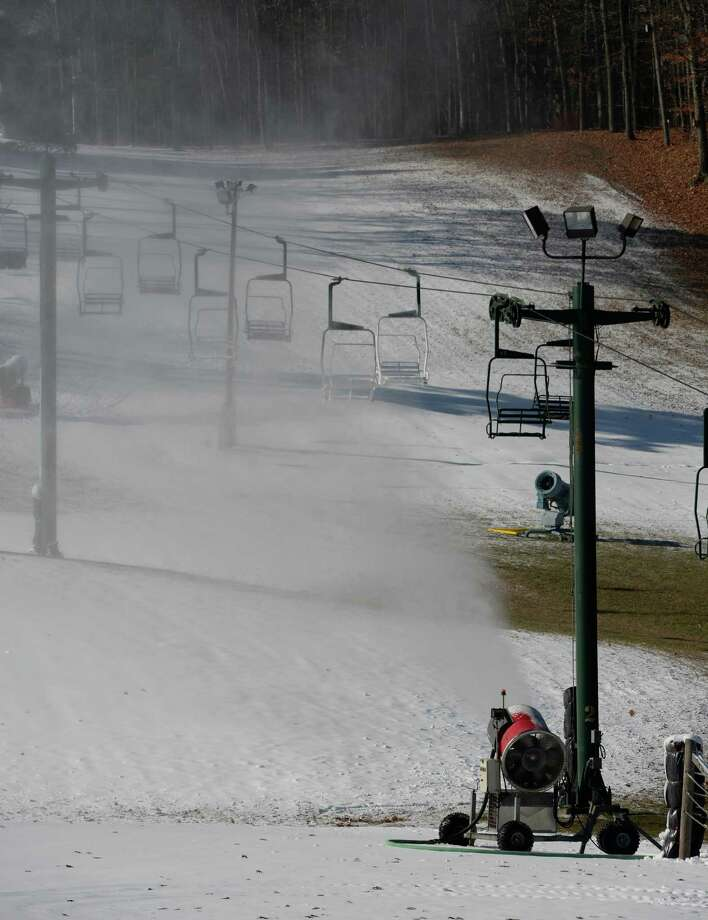 "The snow guns are in full operation at the Maple Ski Ridge Wednesday afternoon Nov. 13, 2013,  in Delanson, N.Y.   According to Kate Michener, director of marketing and sales for Maple Ski Ridge, ""We have been waiting since February of this year to get back on the slopes and provide the best conditions around. We will make as much snow as we can while we can. We anticipate a ""soft"" opening as soon as possible.   (Skip Dickstein/Times Union Photo: SKIP DICKSTEIN / 00024632A"