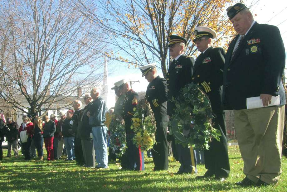 Vietnam War veteran Jeff McBreairty, right, and his fellow honor guard members pay homage to their countless brothers at arms during New Milford's Veterans Day ceremony on the south end of the Village Green in New Milford. Nov. 11, 2013 Photo: Norm Cummings / The News-Times