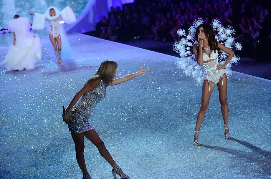 Singer Taylor Swift (L) takes part in the 2013 Victoria's Secret Fashion Show at the Lexington Avenue Armory on November 13, 2013 in New York. AFP PHOTO/Emmanuel DunandEMMANUEL DUNAND/AFP/Getty Images Photo: Emmanuel Dunand, AFP/Getty Images