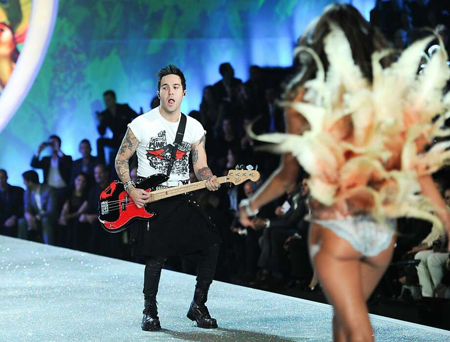 Musician Pete Wentz of Fall Out Boy performs while a model walks the runway during the 2013 Victoria's Secret Fashion Show at the 69th Regiment Armory on Wednesday, Nov. 13, 2013 in New York. (Photo by Evan Agostini/Invision/AP) Photo: Evan Agostini, Associated Press