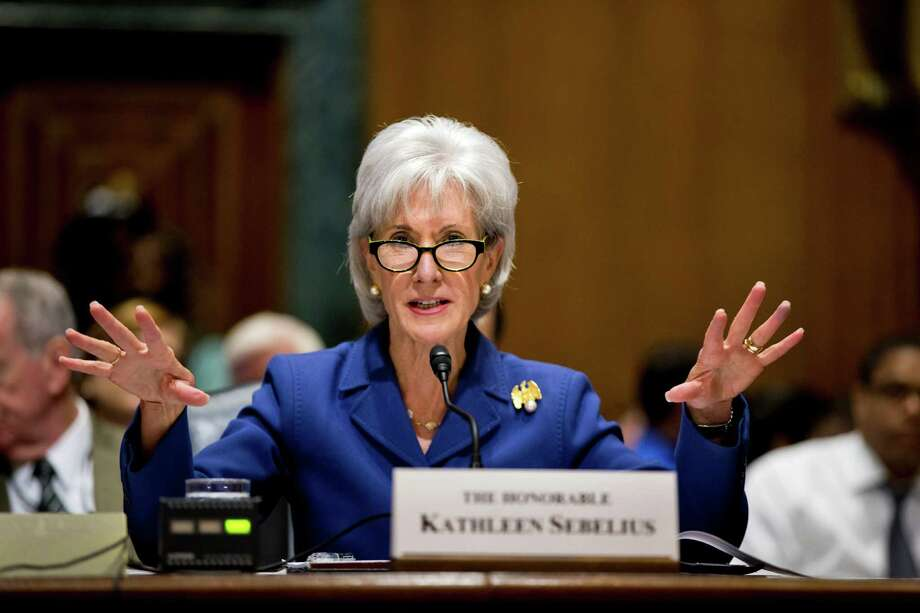 In this Nov. 6, 2013, file photo, Health and Human Services Secretary Kathleen Sebelius testifies on Capitol Hill in Washington on the difficulties plaguing the implementation of the Affordable Care Act. Putting a statistic on disappointment, the Obama administration revealed Wednesday, Nov. 13, that fewer than 27,000 people signed up for private health insurance last month in the 36 states relying on a problem-filled federal website. Photo: J. Scott Applewhite, AP / AP