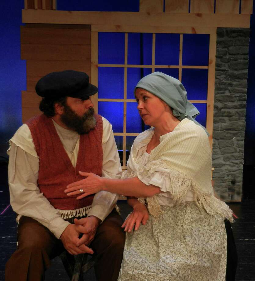 "Tevye, the dairyman, and his long-suffering wife Golde, played by Lou Ursone of Stamford and Jacqueline MacLean of Stratford, in a scene from ""Fiddler on the Roof,"" which will be open this weekend at Curtain Call, a Stamford, Conn.-based nonprofit theater company. Photo: Contributed Photo / Stamford Advocate Contributed"