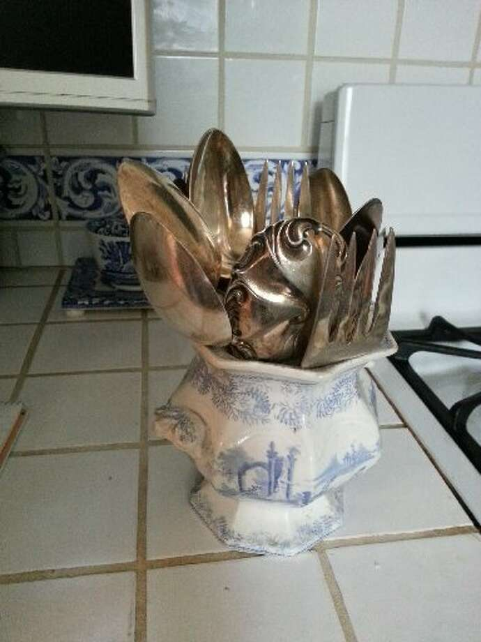 A beautiful porcelain soup tureen that was discarded because of a few cracks and missing top. He snatched it up and turned it into a holder for serving ware and utensils in the kitchen. Photo: Emily Spicer, San Antonio Express-News