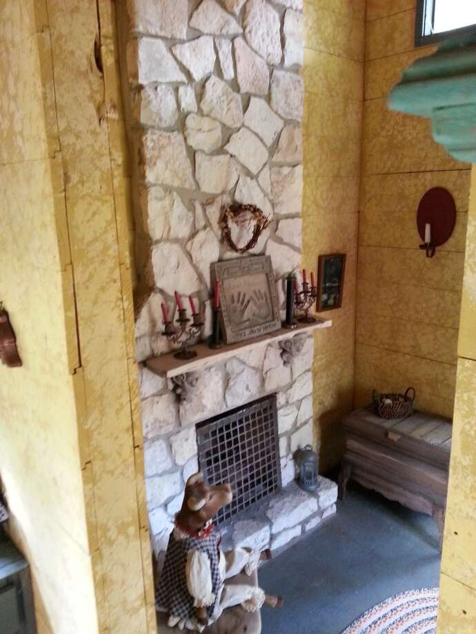 The cabin features a real, working stone fireplace. Photo: Emily Spicer, San Antonio Express-News