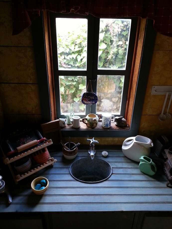 The cabin also has running cold water that drains off to water the garden. Photo: Emily Spicer, San Antonio Express-News