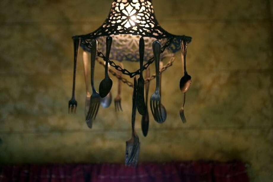 Bloodsworth's wife Jamie made this light fixture out of a discarded silverplate bowl and various silver utensils. It hangs in the cabin. Photo: Helen L. Montoya, San Antonio Express-News