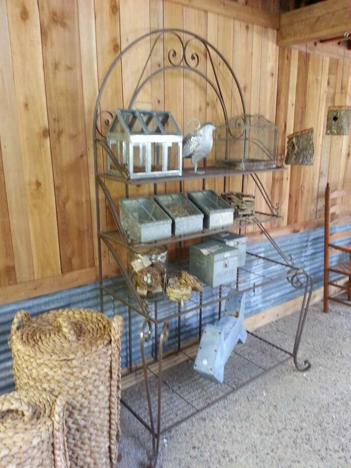 Some of the galvanized metal items Bloodsworth was planning to sell at the House to Home sale in early November. He refurbished the greenhouse space using cedar planks and the place smells divine! Photo: Emily Spicer, San Antonio Express-News
