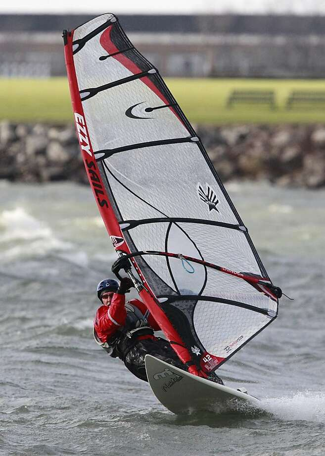 Skimming the waves: Stiff autumn winds make for a good workout for Mark Hemann as he sails off Gallagher Beach in Buffalo, N.Y. Photo: Harry Scull Jr., Associated Press
