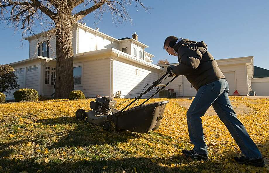 Lots of leaves to mow before I'm done: Jeff Page, funeral director of Heckart Funeral Home in Sedalia, Mo., is also the director of lawn maintenance at Heckart Funeral Home in Sedalia, Mo. Photo: Sydney Brink, Associated Press