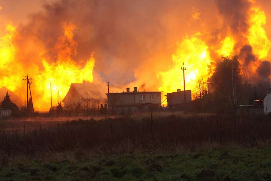 Gas line inferno:Houses burn after a gas pipeline explosion in the Polish village of Jankow Przygodzki village. The line was carrying Russian gas to western Europe. Photo: Thomasz Wojtasik, AFP/Getty Images