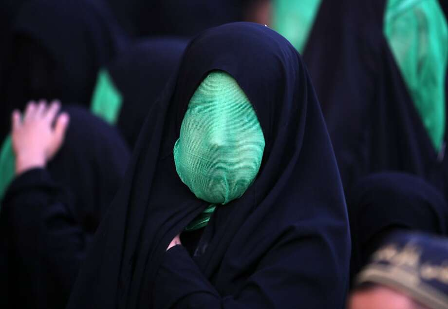 The gaze behind the gauze:A veiled Iraqi Shiite girl takes part in the reenactment of the Battle of Karbala during a parade in Baghdad's northern district of Kadhimiya. Thursday was the climax of the mourning period of Ashura, commemorating the martyrdom of Prophet Mohammed's grandson Imam Hussein. Photo: Ahmad Al-rubaye, AFP/Getty Images