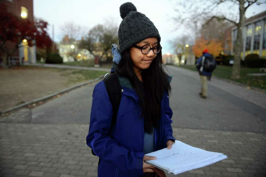 University of Bridgeport freshman Beatrice Cabrera reads a poem that she wrote Wednesday, Nov. 13, 2013 to help her express her feelings about the typhoon that devestated her home country, the Philippines. Photo: Autumn Driscoll / Connecticut Post
