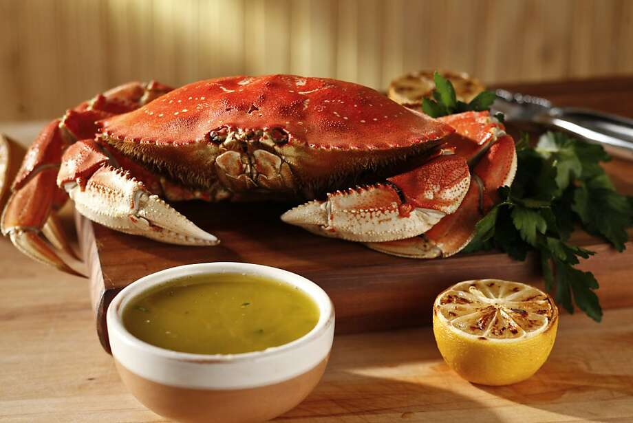 TOP CRAB RECIPES Roasted Lemon Bagna Cauda Makes about 1 1/4 cups Serve this warm bagna cauda from Woodhouse Fish Co. with steamed or boiled Dungeness crab. Ingredients:  6 anchovy filets, rinsed -- Peeled cloves from 1 small head garlic, chopped 1 shallot, minced  1/2 cup (1 stick) unsalted butter 2 tablespoons extra virgin olive oil 1 1/2 teaspoons kosher salt, to taste 4 lemons  1 teaspoon chopped fresh thyme 1 teaspoon chopped parsley -- Fresh ground black pepper, to taste  Instructions: Combine the anchovy, garlic, shallot, butter, olive oil and salt in a small saucepan; cook over medium-low heat about 8-10 minutes. Meanwhile, move the oven rack to the top of the oven; preheat the broiler. Trim the ends of 3 lemons to help them sit flat, then halve each lemon crosswise. Place lemons, cut side up, on a rimmed baking sheet. Broil until caramel brown and fragrant, about 4 minutes. You can also grill them. Grate the zest of the remaining unbroiled lemon into the butter mixture. While the broiled lemons are still warm, juice 4-5 halves, or more to taste, into the butter mixture; if they are too hot, let cool a little or use a pair of tongs. Use any remaining halves as garnish. Stir in the thyme, parsley, salt and pepper. Per tablespoon: 61 calories, 1 g protein, 1 g carbohydrate, 6 g fat (3 g saturated), 13 mg cholesterol, 161 mg sodium, 0 g fiber. Photo: Craig Lee, Special To The Chronicle