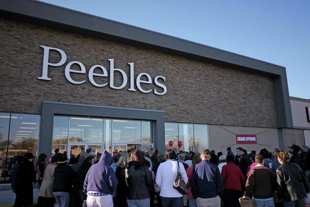In conjunction with the opening of the Peebles Department Store, the Troy Plaza, located at 120 Hoosick St. in Troy, changed its name to Hudson River Commons in November 2013.Customers gather outside before the doors open for the grand opening of the Peebles Department Store in the Troy Plaza on Hoosick Street on Thursday, Nov. 14, 2013 in Troy, NY.  (Paul Buckowski / Times Union) Photo: Paul Buckowski / 00024626A