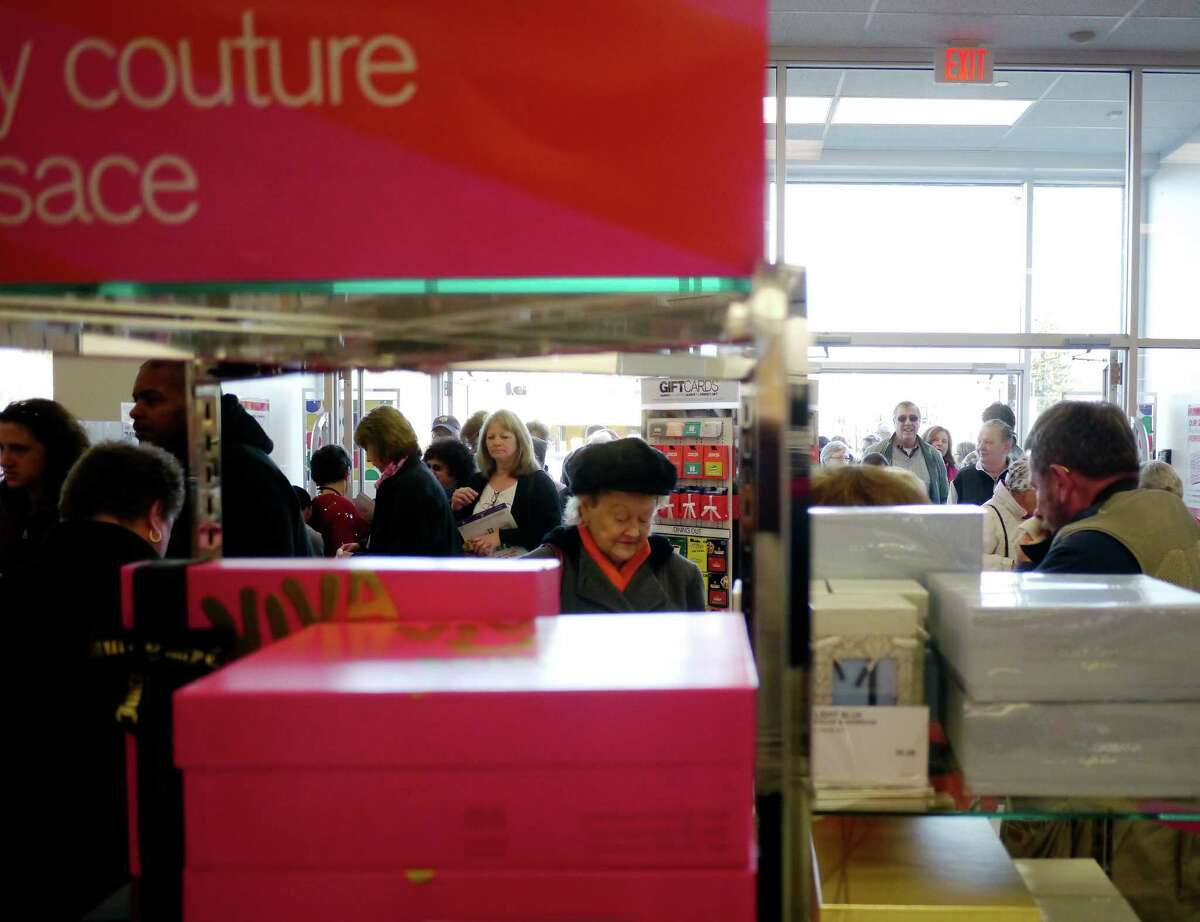 Customers stream through the front doors at the grand opening of the Peebles Department Store in the Troy Plaza on Hoosick Street on Thursday, Nov. 14, 2013 in Troy, NY. (Paul Buckowski / Times Union)