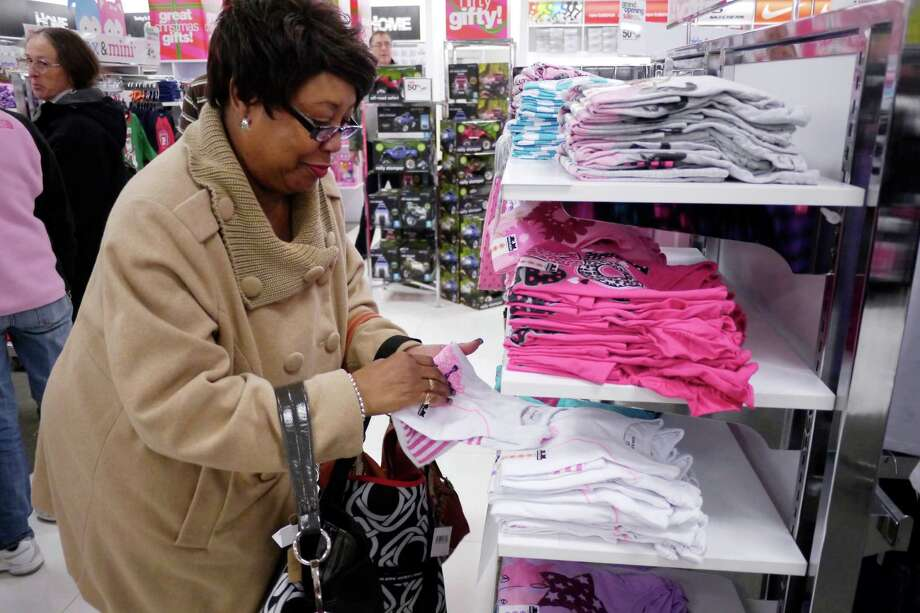 Barbara Pettiway of Troy picks out some shirts for her granddaughter as she shopped during  the grand opening of the Peebles Department Store in the Troy Plaza on Hoosick Street on Thursday, Nov. 14, 2013 in Troy, NY.  (Paul Buckowski / Times Union) Photo: Paul Buckowski / 00024626A