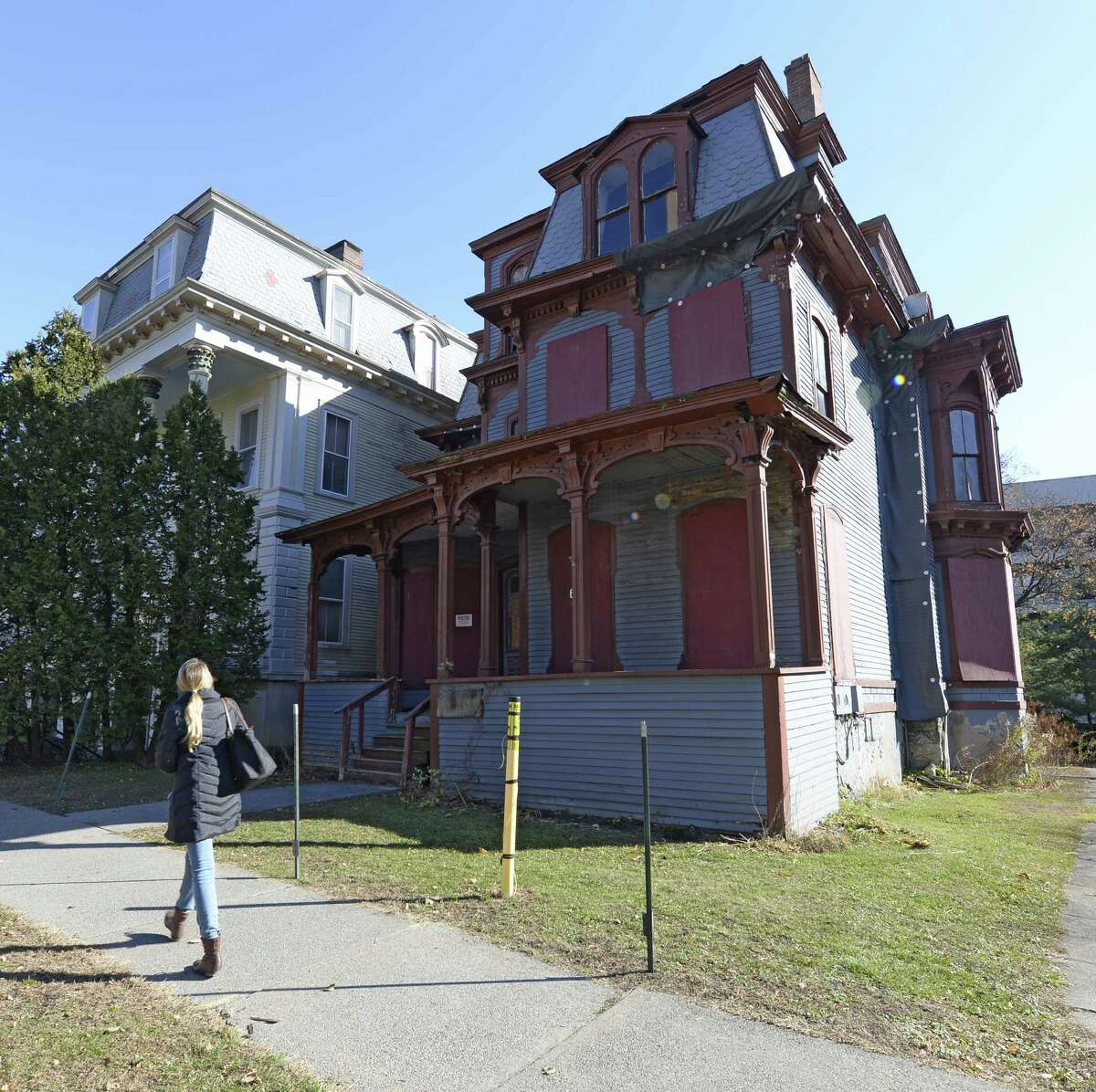 A pedestrian walks past 66 Franklin this morning Nov. 14, 2013 in Saratoga Springs, N.Y. where demolition will commence on that structure. (Skip Dickstein / Times Union)