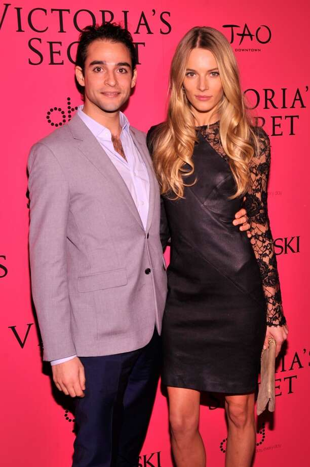 Model Ieva Laguna (R) and guest attend the 2013 Victoria's Secret Fashion Show at TAO Downtown on November 13, 2013 in New York City.  (Photo by Stephen Lovekin/Getty Images) Photo: Stephen Lovekin, Getty Images