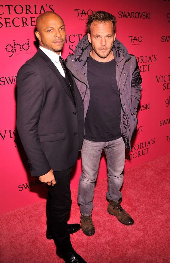 Actor Stephen Dorff (R) and guest attend the 2013 Victoria's Secret Fashion Show at TAO Downtown on November 13, 2013 in New York City.  (Photo by Stephen Lovekin/Getty Images) Photo: Stephen Lovekin, Getty Images