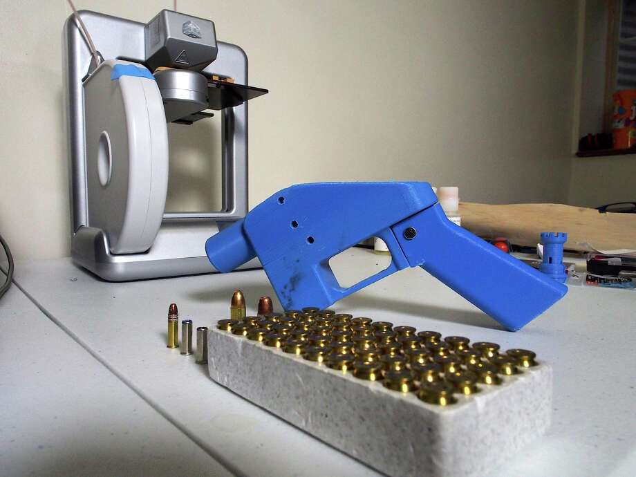 A Liberator pistol appears on July 11, 2013 next to the 3D printer on which its components were made. The single-shot handgun is the first firearm that can be made entirely with plastic components forged with a 3D printer and computer-aided design (CAD) files downloaded from the Internet. Photo: AFP, Robert MacPherson/AFP/Getty Imag / 2013 AFP Robert MacPherson/AFP/Getty Images