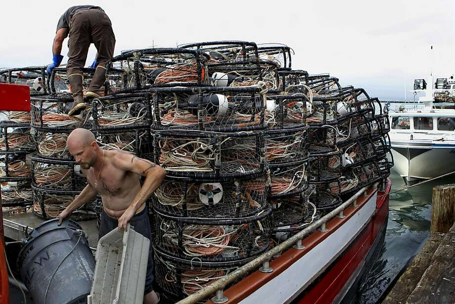 Roger Rowland (top) and Steve Nielsen load the AL-W with empty crab pots. Photo: Michael Macor, The Chronicle
