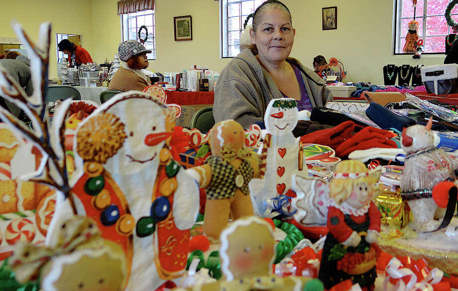 Migdalia Gonzalez offers ornaments, kids apparel and jewelry at Trinity-St. Michael Church Christmas Fair. Photo: Mike Lauterborn / Fairfield Citizen contributed