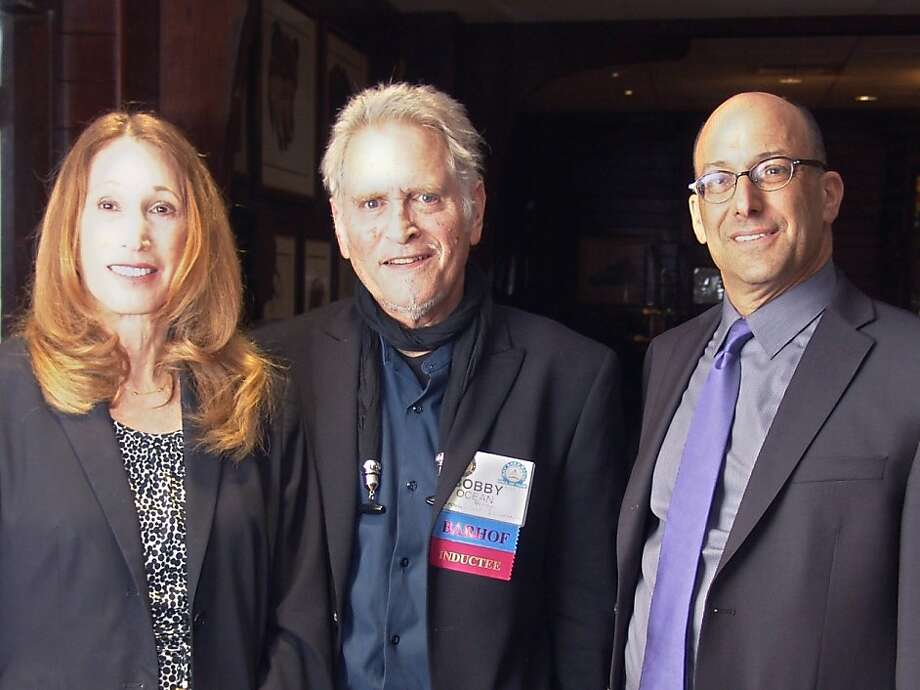 Among the honorees at the Nov. 2 Bay Area Radio Hall of Fame induction luncheon in Berkeley were KCBS' Barbara Taylor (left) and Mike Sugerman (right) and Bobby Ocean. Photo: Robert Mohr, Stock Options