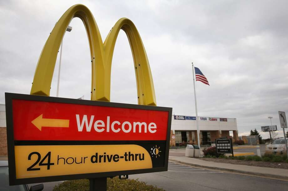 DES PLAINES, IL - OCTOBER 24:  A sign directs customers to the drive-thru at a McDonald's restaurant on October 24, 2013 in Des Plaines, Illinois. McDonald's has announced it will make changes to its low-priced Dollar Menu, which includes items like coffee, small fries, hamburgers and apple pies. The new menu, dubbed the Dollar Menu and More, will offer some higher priced options such as the grilled Onion Cheddar Burger and a McChicken sandwich.  (Photo by Scott Olson/Getty Images) Photo: Getty Images