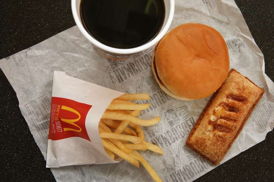DES PLAINES, IL - OCTOBER 24:  In this photo illustration, items from a McDonald's restaurant are shown on October 24, 2013 in Des Plaines, Illinois. McDonald's has announced it will make changes to its low-priced Dollar Menu, which includes items like coffee, small fries, hamburgers and apple pies. The new menu, dubbed the Dollar Menu and More, will offer some higher priced options such as the grilled Onion Cheddar Burger and a McChicken sandwich.  (Photo Illustration by Scott Olson/Getty Images) Photo: Getty Images