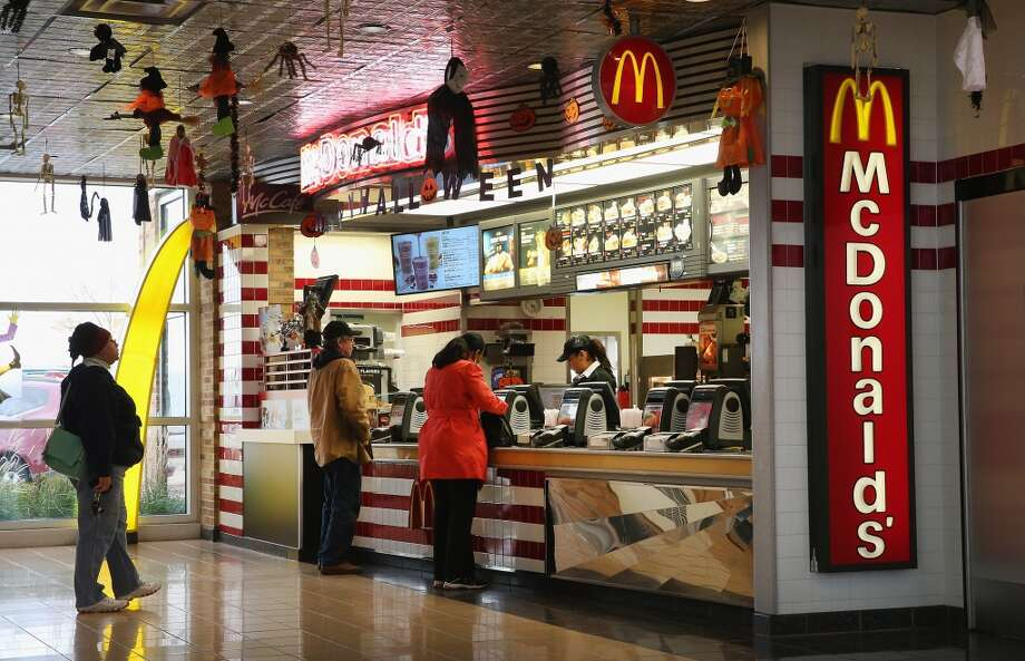 DES PLAINES, IL - OCTOBER 24:  Customers order food from a McDonald's restaurant on October 24, 2013 in Des Plaines, Illinois. McDonald's has announced it will make changes to its low-priced Dollar Menu, which includes items like coffee, small fries, hamburgers and apple pies. The new menu, dubbed the Dollar Menu and More, will offer some higher priced options such as the grilled Onion Cheddar Burger and a McChicken sandwich.  (Photo by Scott Olson/Getty Images) Photo: Getty Images