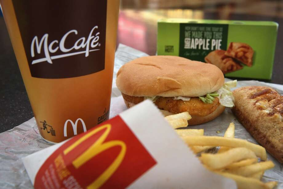 DES PLAINES, IL - OCTOBER 24:  In this photo illustration, a McChicken sandwich sits with typical Dollar Menu items sold at a  McDonald's restaurant on October 24, 2013 in Des Plaines, Illinois. McDonald's has announced it will make changes to its low-priced Dollar Menu, which includes items like coffee, small fries, hamburgers and apple pies. The new menu, dubbed the Dollar Menu and More, will offer some higher priced options such as the grilled Onion Cheddar Burger and a McChicken sandwich.  (Photo Illustration by Scott Olson/Getty Images) Photo: Getty Images