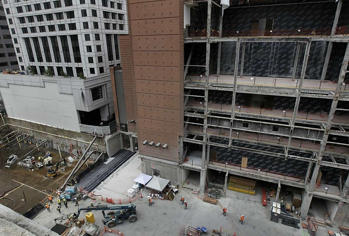 The east side of the building is exposed as construction continues on the expansion of the San Francisco Museum of Modern Art in San Francisco, Calif. on Thursday, Nov. 14, 2013. The W Hotel is seen at far left.