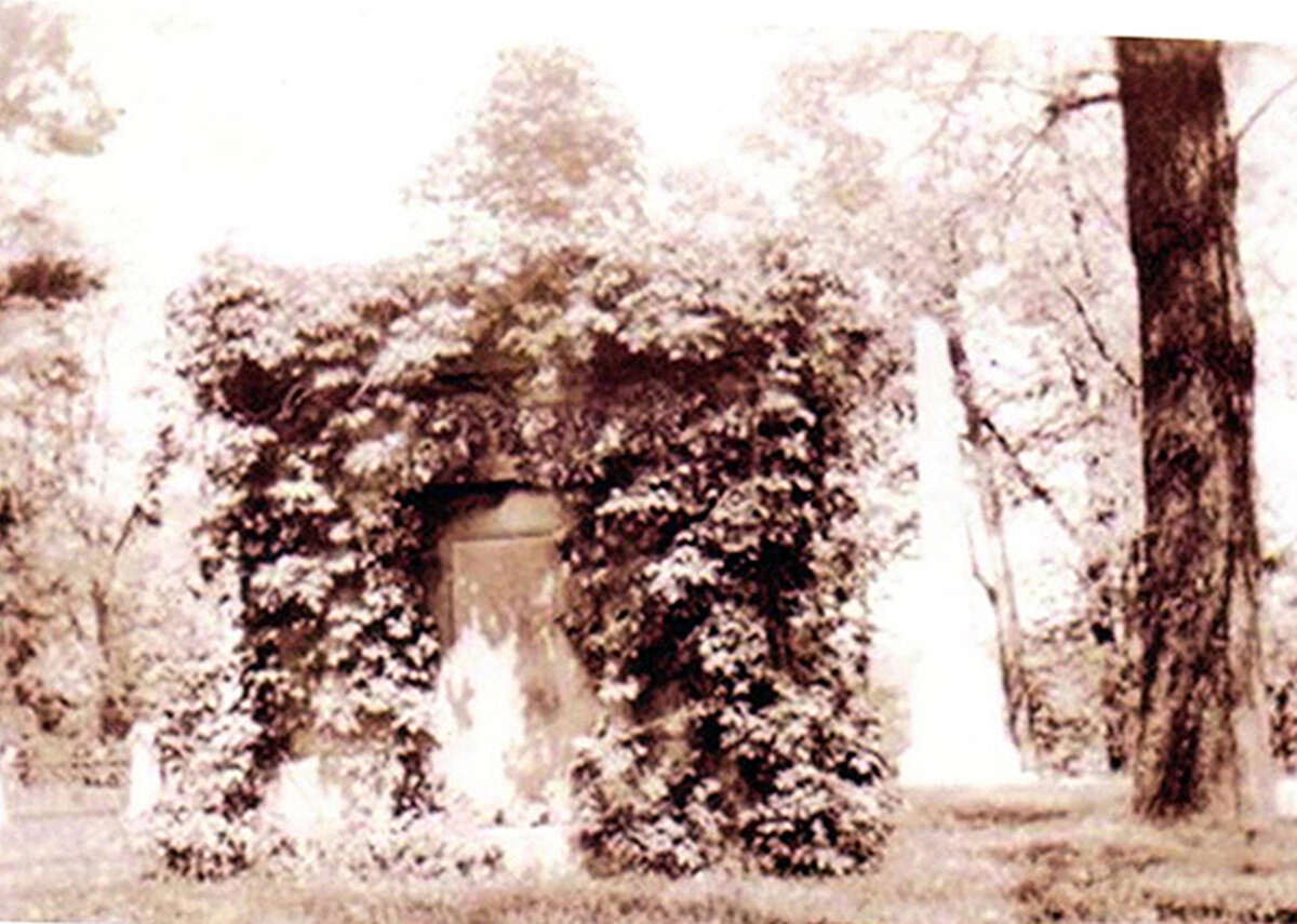 Catharine Hamilton's vine-covered tomb, circa 1940. An 1871 guide noted it would likely fall or be taken down due to poor construction.