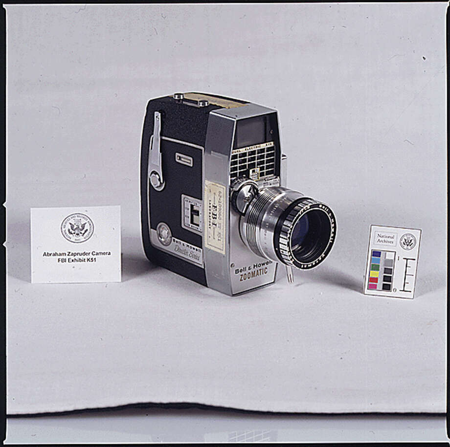 This image made available by the National Archives shows a 1963-1964 photograph of the movie camera used by Abraham Zapruder when he filmed the moment of the assassination of U.S. President John F. Kennedy on Nov. 22, 1963. Standing on a 4-foot-high concrete pedestal, his receptionist bracing him from behind, the 58-year-old Russian immigrant followed the progress of JFK's blue Lincoln limousine as it rolled toward him down Elm Street. (AP Photo/National Archives) ORG XMIT: NY931 / National Archives