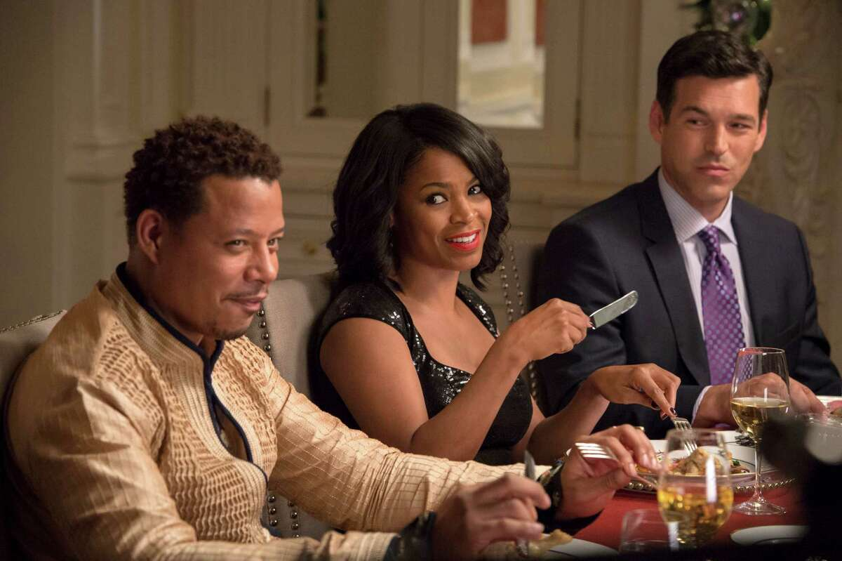 """This image released by Universal Pictures shows, from left, Terrence Howard, Nia Long and Eddie Cibrian in a scene from """"The Best Man Holiday."""" The movie releases in theaters Friday, Nov. 15, 2013. (AP Photo/Universal Pictures, Michael Gibson) ORG XMIT: CAET462"""