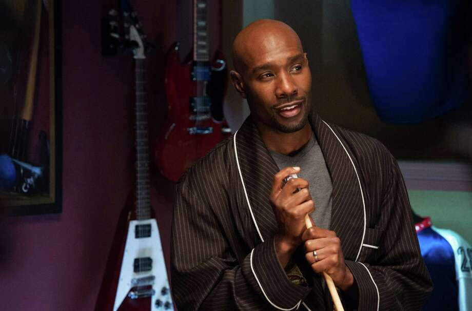 "This photo provided by NBCUniversal shows Morris Chestnut as Lance in ""The Best Man Holiday.""  The movie releases in theaters Friday, Nov. 15, 2013. (AP Photo/Universal Pictures, Michael Gibson) ORG XMIT: CAET352 Photo: Michael Gibson / Universal Pictures"