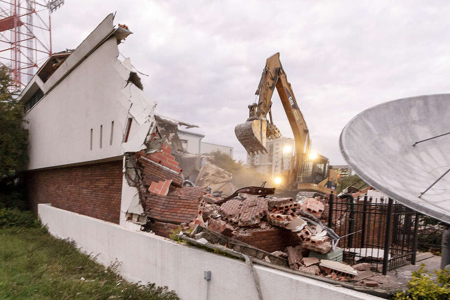 The Univision building on César E. Chávez Boulevard is demolished. Spanish-language broadcasting in the U.S. began here. One person's rubble is another person's history. Photo: Marvin Pfeiffer / San Antonio Express-News