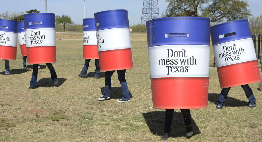 "A reader takes the popular phrase ""Don't Mess with Texas"" (promoted here by the Odessa College Cheer Team) and applies it to President Barack Obama. Photo: Associated Press File Photo"