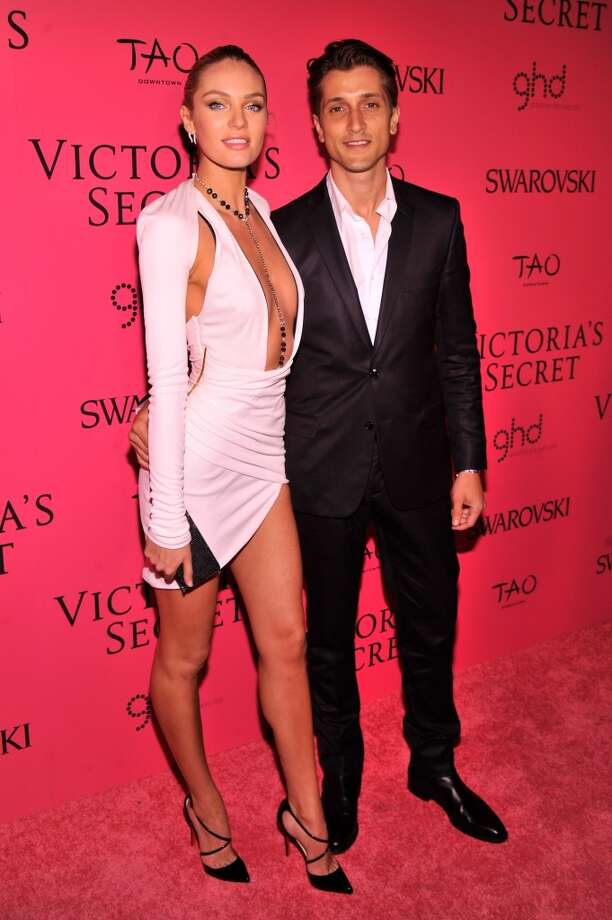 Model Candice Swanepoel and Hermann Nicoli attend the 2013 Victoria's Secret Fashion Show at TAO Downtown on November 13, 2013 in New York City.  (Photo by Stephen Lovekin/Getty Images) Photo: Stephen Lovekin, Getty Images