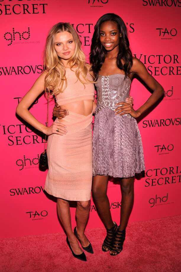 Models Magdalena Frackowiak (L) and Maria Borges attend the 2013 Victoria's Secret Fashion Show at TAO Downtown on November 13, 2013 in New York City.  (Photo by Stephen Lovekin/Getty Images) Photo: Stephen Lovekin, Getty Images