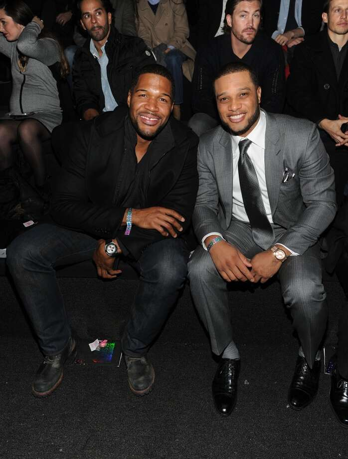Michael Strahan and Robinson Cano attends the 2013 Victoria's Secret Fashion Show at Lexington Avenue Armory on November 13, 2013 in New York City.  (Photo by Jamie McCarthy/Getty Images) Photo: Jamie McCarthy, Getty Images