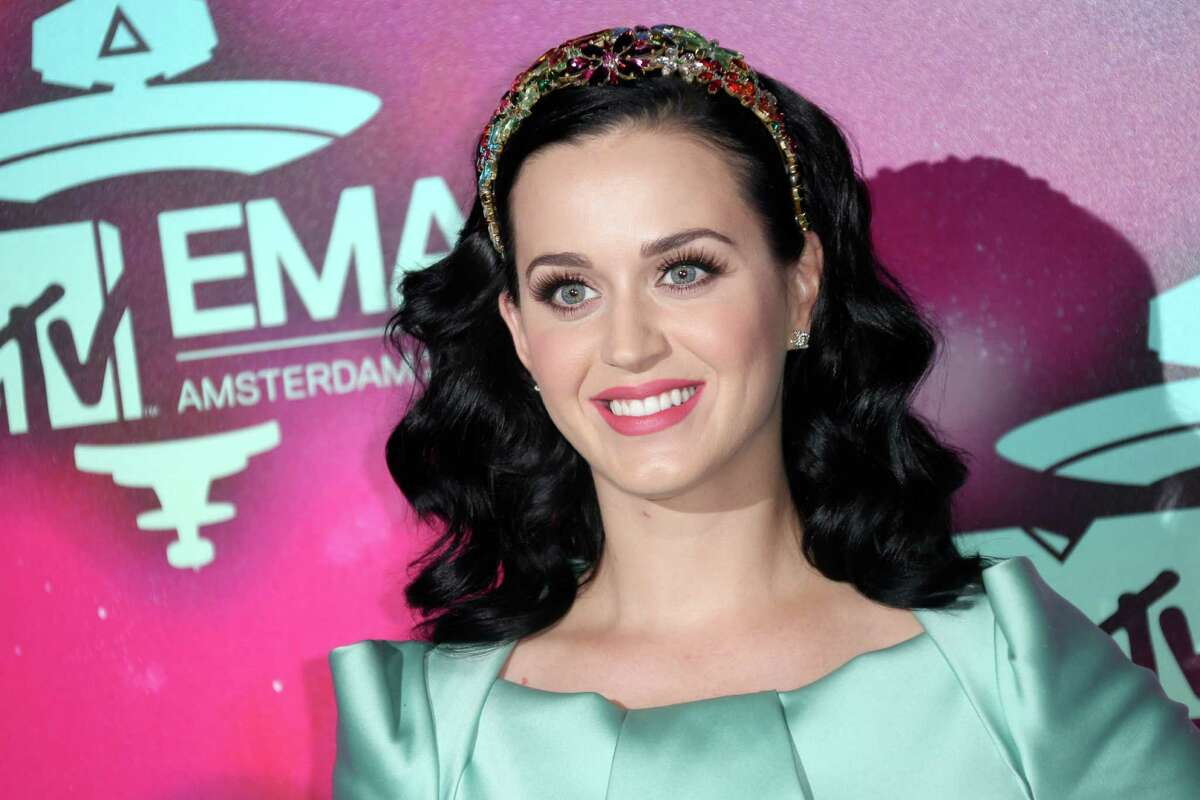 """FILE - This Nov. 10, 2013 file photo shows U.S. singer Katy Perry at the 2013 MTV Europe Music Awards, in Amsterdam, Netherlands, Perry will kick off the Nov. 24 American Music Awards with a performance of her new single ?""""Unconditionally.?"""" (Photo by Joel Ryan/Invision/AP, File) ORG XMIT: NYET215"""