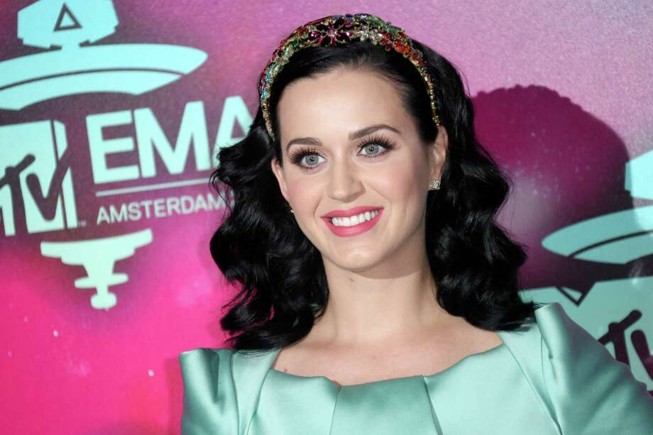 "FILE - This Nov. 10, 2013 file photo shows U.S. singer Katy Perry at the 2013 MTV Europe Music Awards, in Amsterdam, Netherlands, Perry will kick off the Nov. 24 American Music Awards with a performance of her new single ""Unconditionally."" (Photo by Joel Ryan/Invision/AP, File) ORG XMIT: NYET215 Photo: Joel Ryan / Invision"