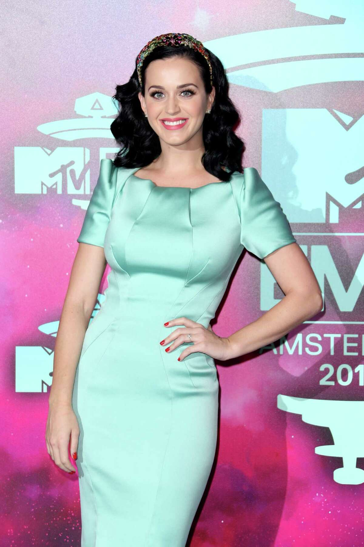 """FILE - In this Nov. 10, 2013 file photo, U.S. singer Katy Perry poses at the 2013 MTV Europe Music Awards, in Amsterdam, Netherlands, Perry will kick off the Nov. 24 American Music Awards with a performance of her new single ?""""Unconditionally.?"""" (Photo by Joel Ryan/Invision/AP, File) ORG XMIT: NYET216"""